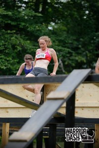 <b>Rachel competing at Warrior Dash 2014 in Horseshoe Valley - this obstacle tests balance and strength  </b>